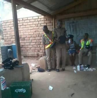 Malawi Police officers drinking beer