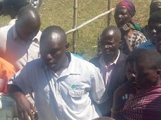 Cooporate affairs Manager Horace Boti addressing farmers before donation