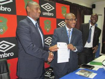FAM's Walter Nyamilandu shows the contract together with FDH's