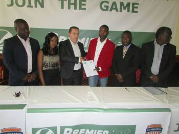 Mponda 9In red jacket) with Premier Bet representatives at the ceremony.
