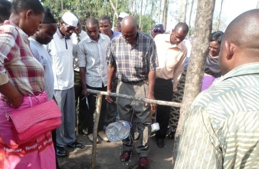 a-community-member-showing-off-a-home-made-hand-washing-facility