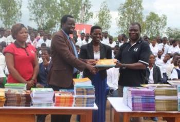 All smiles - Kadango (R) presenting books to Milazie (M) and Tembo( L)