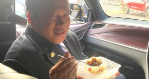 The Pontian Member of Parliament, Datuk Seri Ahmad Maslan uploaded a picture of him having his breakfast in the car on his journey to Putrajaya to attend a briefing on the Proclamation of Emergency. PIX: Ahmad Maslan's Twitter