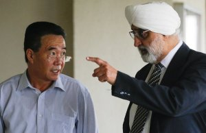 businessman Mun Chol Myong (left) and his lawyer, Jagjit Singh at ther Kuala Lumpur Courts Complex in 2019. PIX: Agensi extradition North Korea US United States America money-laundering Malaysia