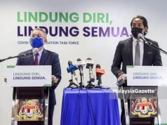 Minister of Health Datuk Seri Dr Adham Baba (left) and the Minsiter of Science, Technology and Innovation cum the Coordinating Minister of the National Covid-19 Immunisation Programme (PICK), Khairy Jamaluddin Abu Bakar at a joint-news conference full scale MCO Selangor