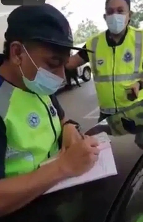 The SOP Compliance Observation team issues a compound to the youth who did not wear face mask.