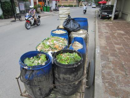 Garbage collected from restaurants appears to contain perfectly edible food -- for example, salad greens in the foreground.