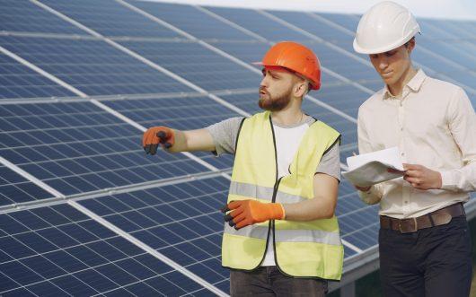 Optimized-foreman-and-businessman-at-solar-energy-station-3GJA6RK