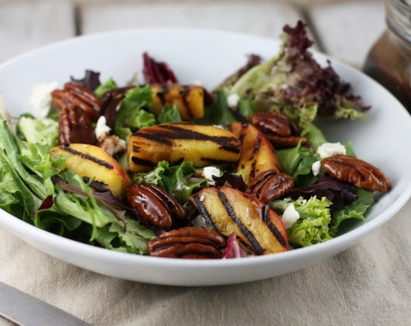 grilled peach salad, candied pecans + balsamic dressing