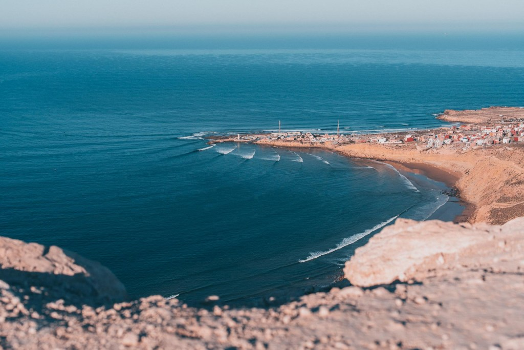 View of the Bay, Imsouane, Morocco from above. The lines of the waves coming into the bay.