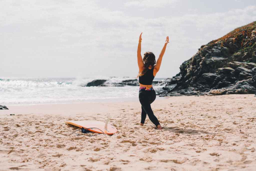 Surf yoga girl workshop warrior 1 virabadrasana
