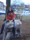 Yes that is a giant cat. Yes my friend is riding it.