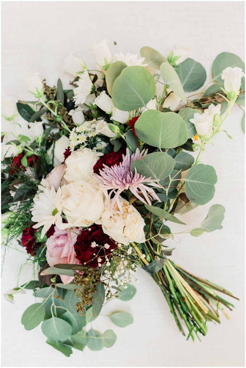 Bridal bouquet with maroon, dusty rose and eucalyptus