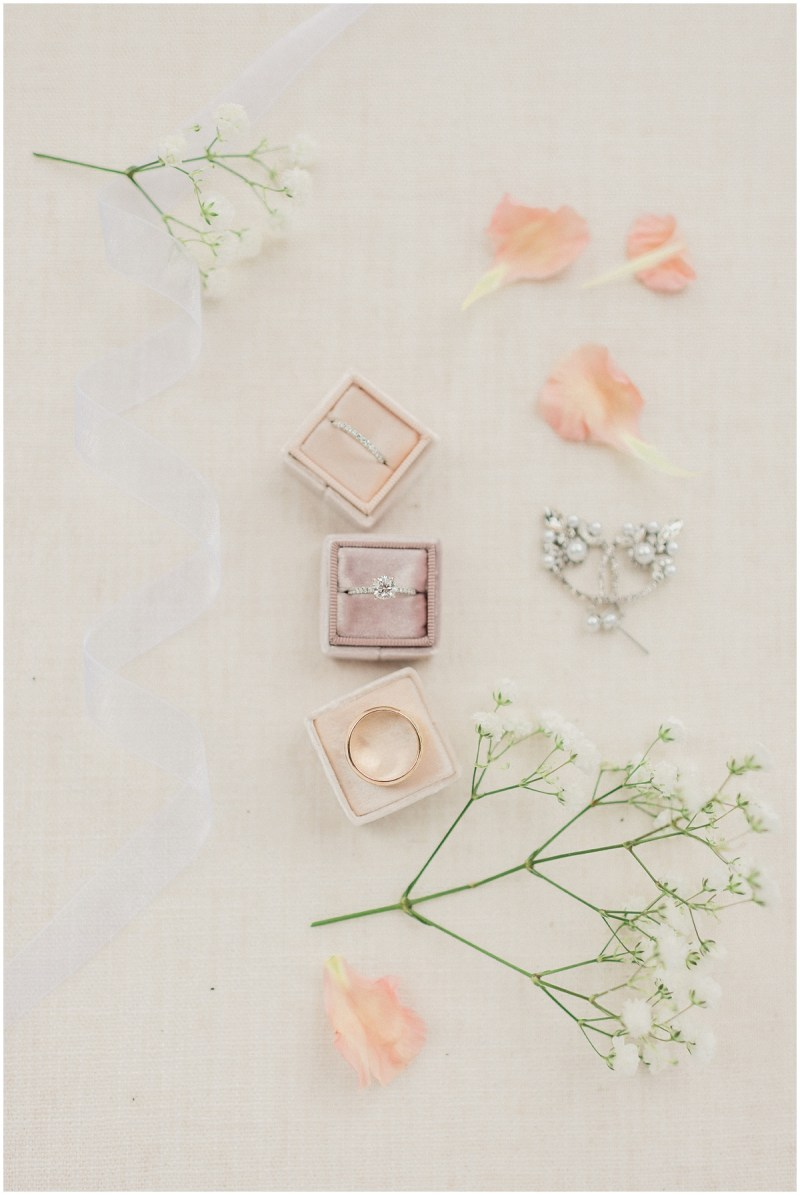 Dusty rose wedding ring flat lay