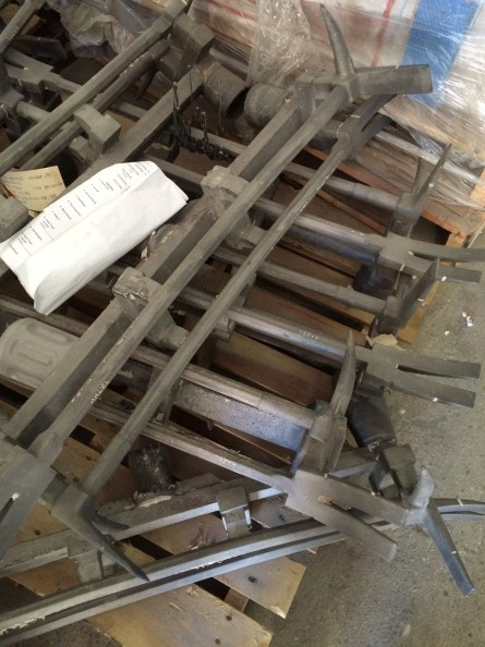 """Cluster of raw investment castings of straight-adzed """"Classic"""" Halligan bars."""