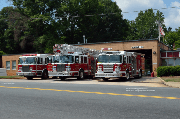 Station 13's apparatus stable in the early 2000's when the photo of Truck 13's front bumper was taken: an engine, a truck, and a 2-piece haz-mat unit.