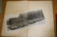 Book with the registration of the first student in 1903 and a photo of the school.