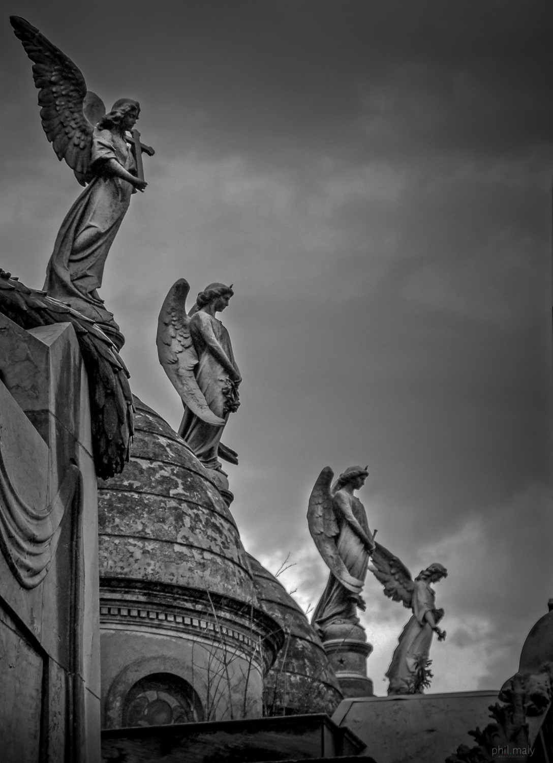 Angels protecting the graves of the Recoleta cemetery