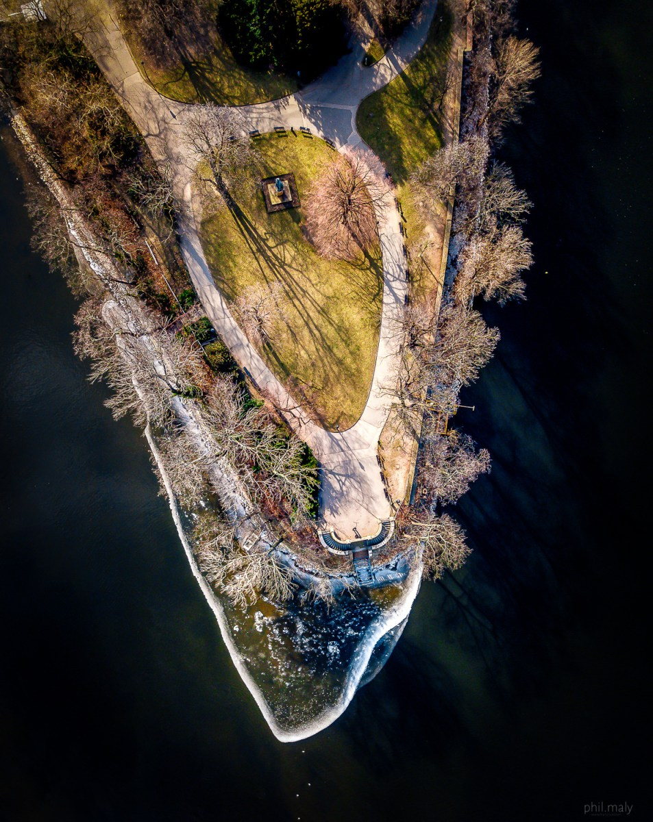 Top down shot of a frozen island on the Vltava river