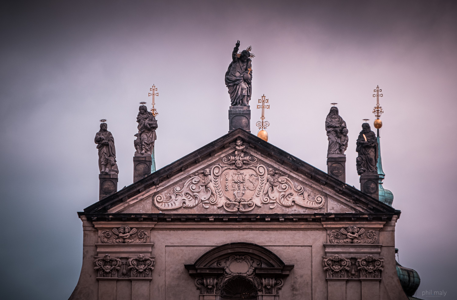 The statues of the saints on the roof of a church