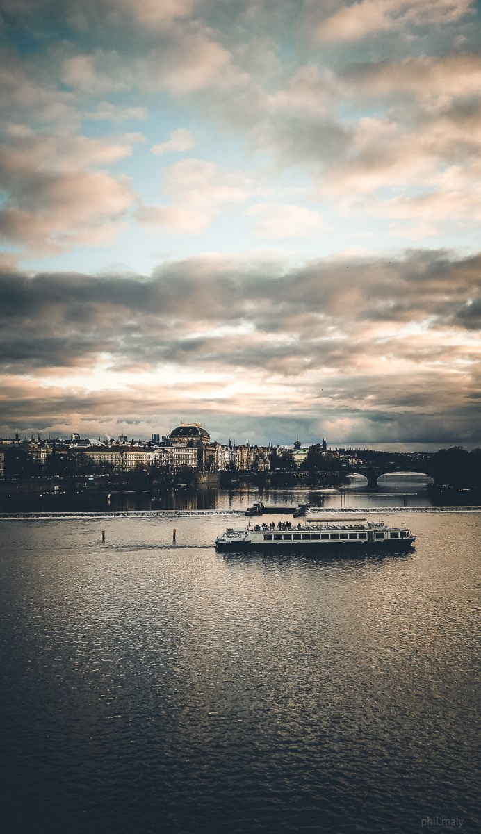 Boat on the Vltava river at sunset