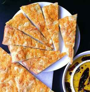 Cheesy Focaccia Flatbread. Salty and flavourful, this cheesy focaccia flatbread is sure to stir your senses.