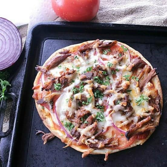Leftover Rib Naan Bread Pizza. A delicious way to use up saucy ribs for a mouthwatering quick meal the whole family will love.