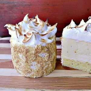 Lemon Meringue Cheesecake Cake for Two. Three layers of epic proportion. Fluffy lemon cake, creamy lemon cheesecake topped off with a perfect toasted meringue.