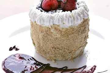 "Raspberry Cheesecake Cake for Two. Velvety cream cheese, sweet raspberry sauce and chocolate covered raspberries tie together to create a 3"" circle of creamy perfection. Try this recipe for cheesecake with raspberry sauce tonight!"