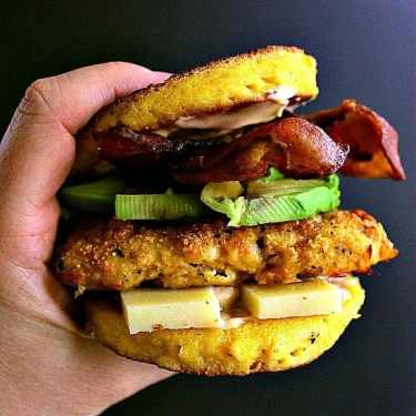 Low Carb Chipotle Chicken Burger. Deliciously breaded chipotle chicken burger loaded with aged cheddar, crisp bacon, thick sliced avocado and sandwiched together by a cheesy 90 second keto bun.