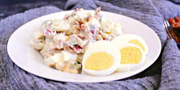 A low carb alternative for when you are craving potato salad, this Cauliflower Potato Salad is loaded with bacon, eggs and saucy goodness!