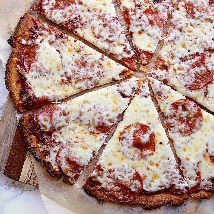 This Fathead Pizza Crust will be your next best friend. It's low carb, acts like pizza and tastes LIKE PIZZA!