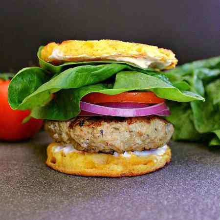 These Low Carb Greek Turkey Burgers are fully loaded with greek style goodies and can be smothered in tzatziki sauce or sandwiched together with tomatoes, spinach and red onion on a 90 Second Keto Bread.