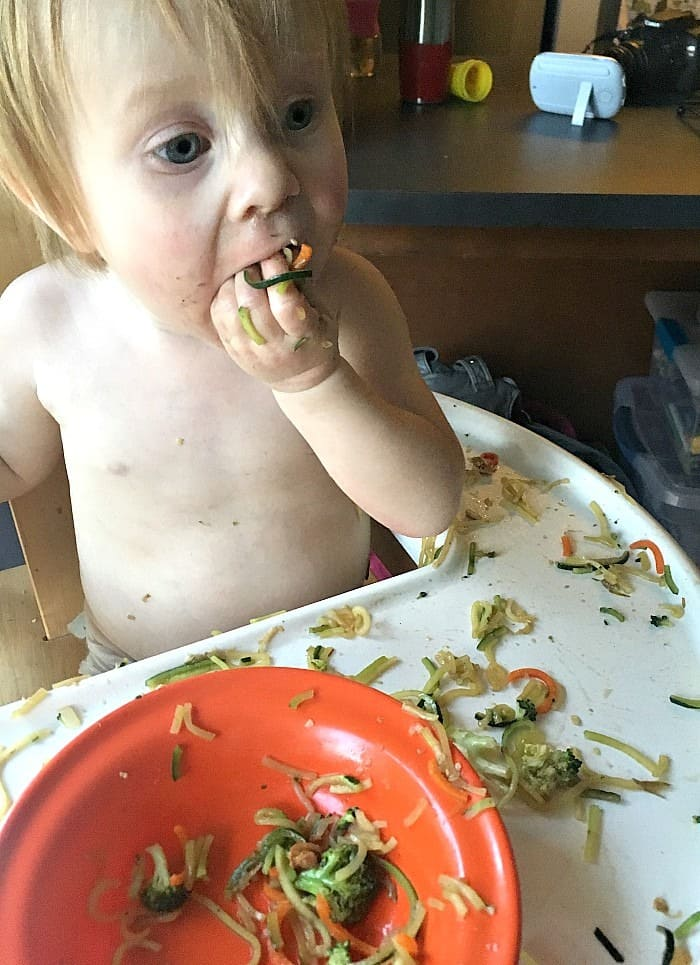 super cute Addilyn stuffed her face with zucchini noodle stir fry.