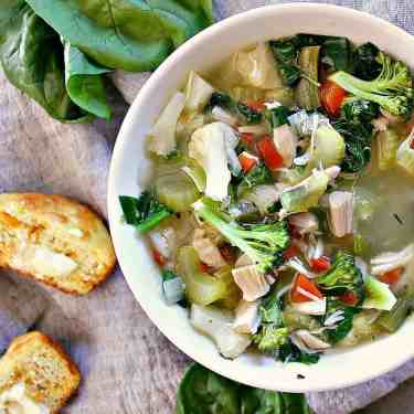 Kick the keto flu or warm your bones with this Fully Loaded Low Carb Chicken Soup. Crammed with veggies this bowl of goodness will leave you fully satisfied.