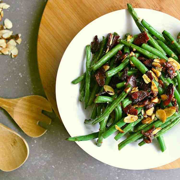 bowl of low carb green beans with almonds and bacon.