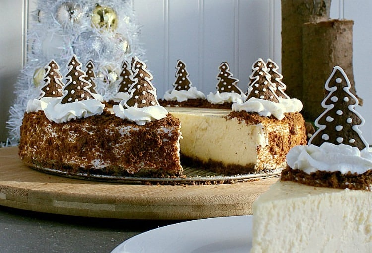 Gingerbread crust cheesecake with one slice removed.