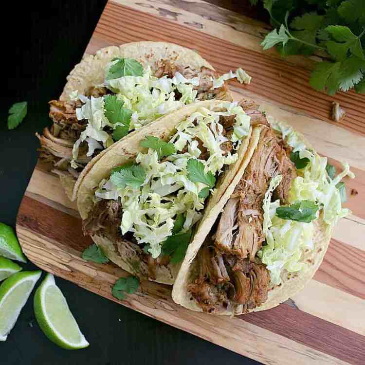 These Instant Pot Carnitas are dripping with flavour and ready in a fraction of the time. Load up corn tortillas or enjoy them low carb with lettuce wraps!