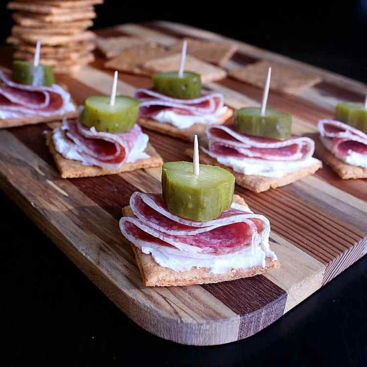 Low Carb Cheese Crackers with cream cheese, salami and pickles.