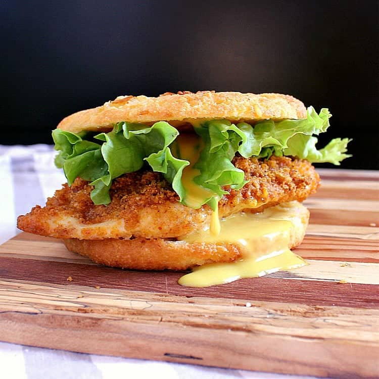 Keto Chicken Burger with keto honey mustard on a low carb onion bun.