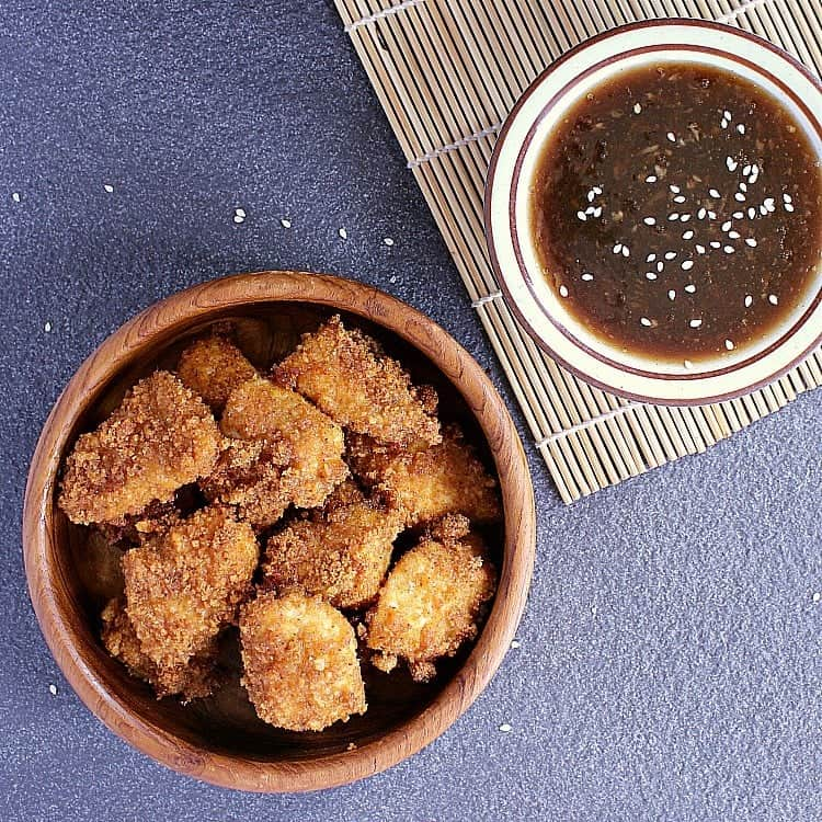 Bowl of crispy low carb chicken nuggets next to some low carb honey garlic.