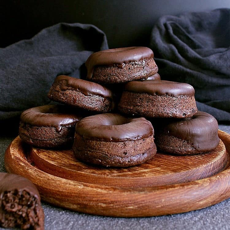 Wooden platter with pile of mini keto chocolate donuts.