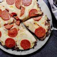 Keto Chicken Pizza Crust with mozzarella and pepperoni.