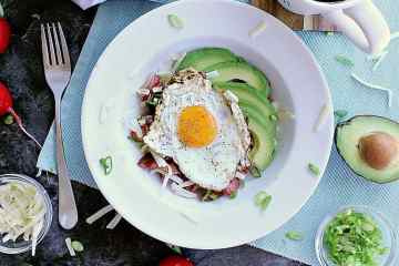 Low Carb Hash Boat. Bed of roasted radishes with bacon, grated cheese and green onion. Fried egg on top with sliced avocado beside it.