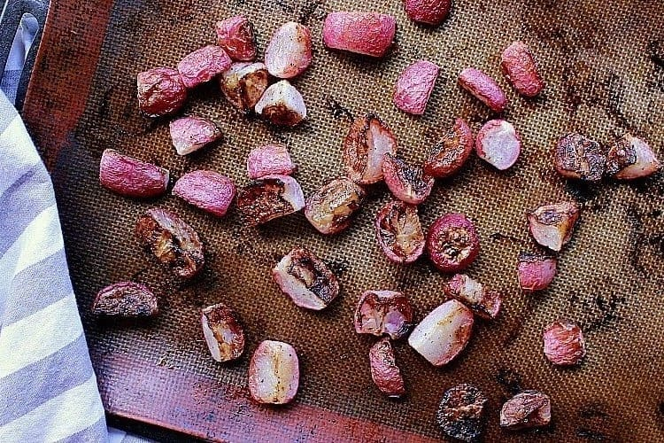 Baking sheet of crisp radishes, fresh from the oven.