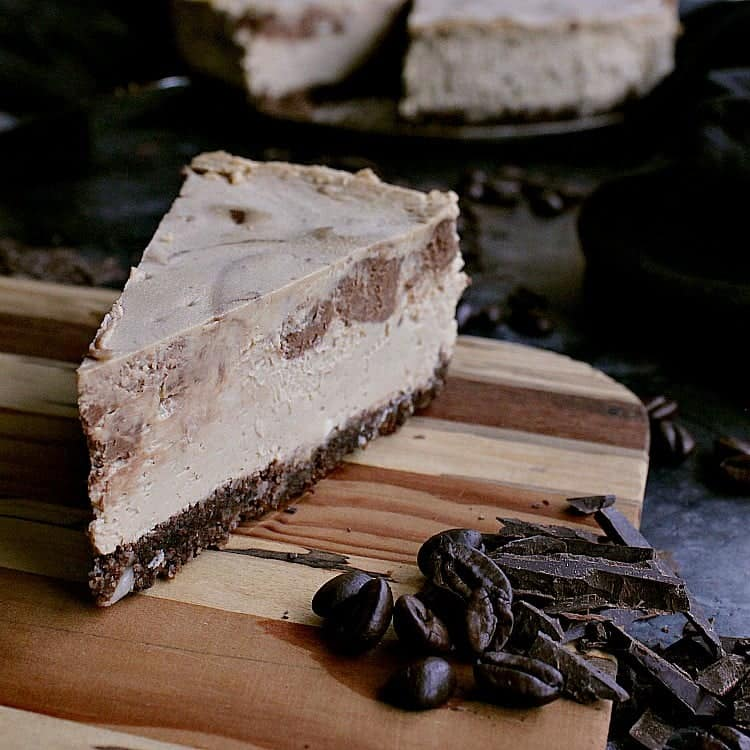 keto mocha cheesecake with one slice removed.