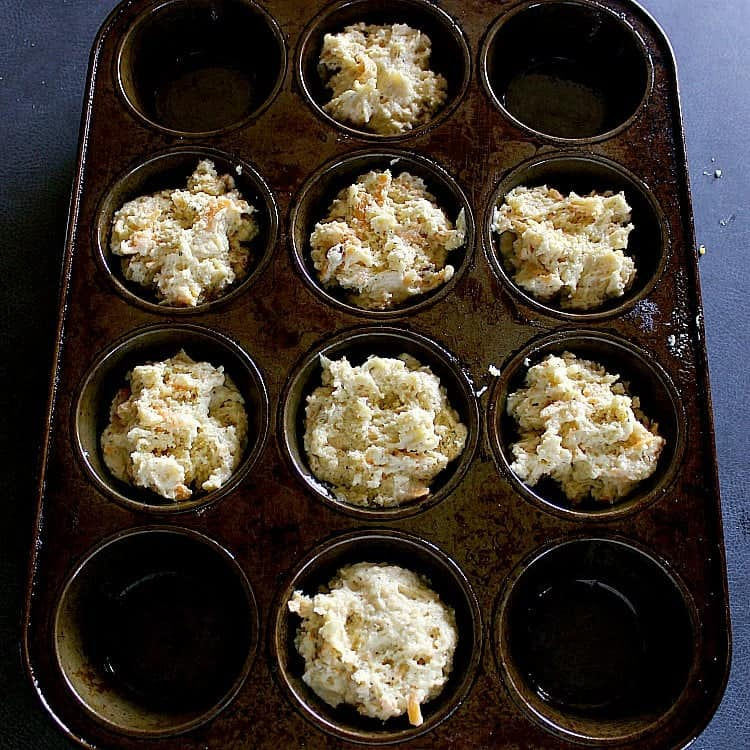 Low Carb Biscuits batter scooped into a muffin tin.