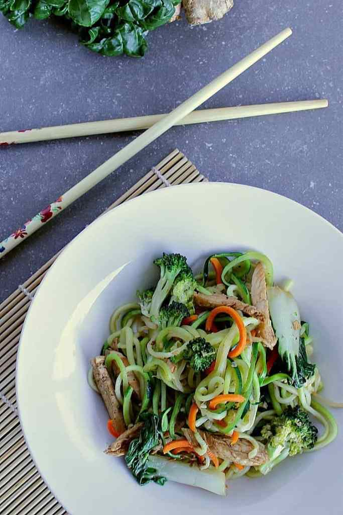 bowl of low carb zucchini noodle stir fry.