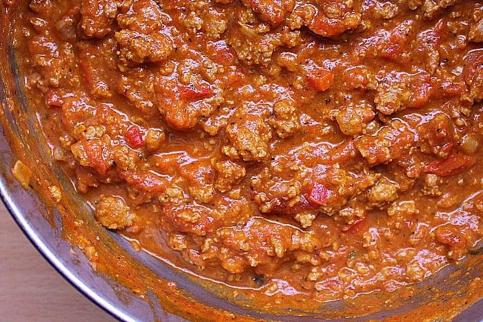 Saucepan full of meat sauce.