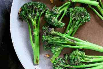 Skillet full of sautéed broccolini.